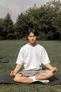 Person Practicing Soothing Rhythm Breathing in CFT